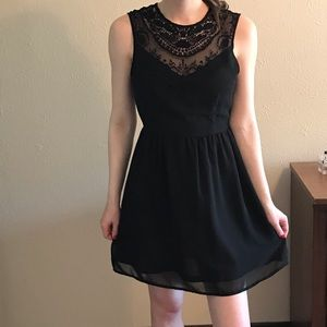 Black sleeveless dress with crocheted detail
